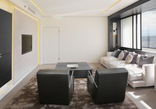 immo-hotel-chambre-salon-fauteuil